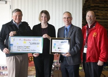 Associated Grocers of New England's Rick Wheeler (Vice President of Wholesale Merchandising & Procurement) and Jim Gaudet (Senior Loss Prevention Officer) present Erin Reardon (Chair, Year-Round Distribution Project) and  John Greabe (Chair, Capital Region Food Program) with a $5000 donation on Tuesday, April 12, 2011.