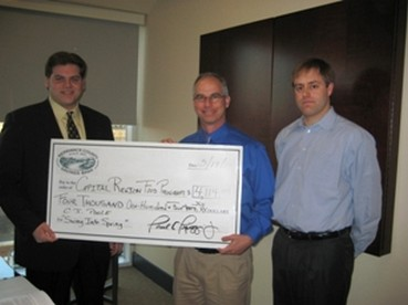 "Bow High School Senior C.J. Poole presents a check from ""Swing into Spring"" to CRFP Chair John Greabe and CRFP Development Chair 3/12/10."
