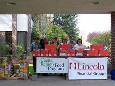 Concord's Lincoln Financial Group's Employee Activities Committee host a food drive that collected  one half-ton of food for the Capital Region Food Program on 4/22/10.