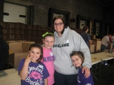 Tara, Marissa, Bella and Sofia Payne of Concord help sort non-perishable food items at the 2011 Stamp Out Hunger Food Drive, 5/14/11.