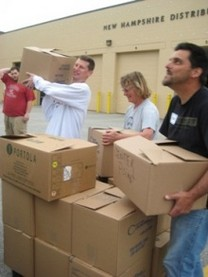 CRFP volunteers load up the last of the partner agency's trucks, 2011 Stamp Out Hunger Food Drive, 5/14/11
