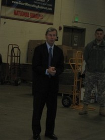 Governor John H. Lynch addresses the volunteers during the Holiday Food Basket Project's Blessing of the Boxes ceremony on December 16, 2010.