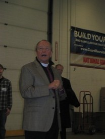 Bishop Gene Robinson addresses the volunteers during the Blessing of the Boxes ceremony on Thursday, December 16, 2010.